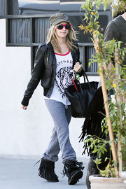 Ashley Tisdale dressed up a pair of gray fleece pants with a leather bomber jacket.