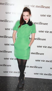 Roxanne Mesquida teamed her neon Peter Pan collared frock with opaque tights and black suede pumps.
