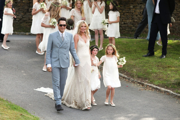 Kate+Moss in THE BRIDGE & GROOM: The Happy newlywed couple Jamie Hince and Kate Moss, holding hands with her daughter Lila Grace, are pictured following the ceremony in Cotswolds