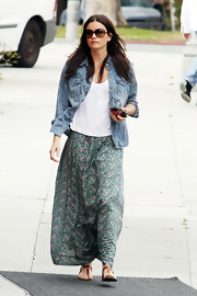 Courtney Robertson was boho-chic in a long floral print skirt.