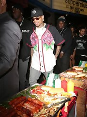 Chris Brown rocked a floral-print baseball jersey as he exited Supper club.