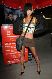 The outrageous Miss Bai Ling struck a pose with a black leather cross-body bag.