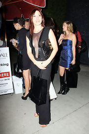 Jessica Sutta was seen out at the Trousdale Club with her oversized leather clutch.