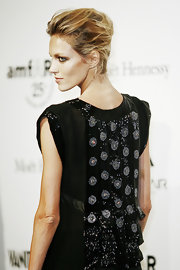 Anja Rubik topped off her look with a sexy French twist when she attended the amfAR Milano event.