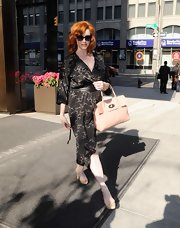 The glamorous Christina Hendricks stepped out in sexy shimmering slingbacks.