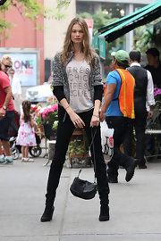 Behati paired this gray and black cardigan over her adorable 'Tres Chic Tres Jolie' tee while on a photo shoot.