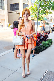 Bella's checkered Louis Vuitton bowler bag added a touch of sophistication to her vibrant ensemble.
