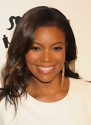 Gabrielle Union swept on a sheer shimmering gloss to complete her radiant look.