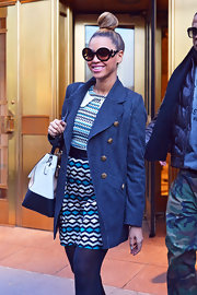 Beyonce looked so charming in this gray wool pea coat with gold buttons while out Christmas shopping in NYC.