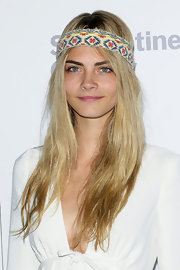 Cara Delevingne tied a printed headband around over her forehead at Burberry's Serpentine Summer Party.