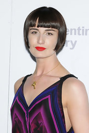 Erin O'Connor, at the Burberry Serpentine Summer Party 2011, accessorized her outfit with a delicate gold chain with a gold pendant in the shape of a key.