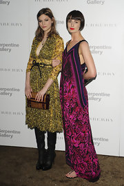 At the Burberry Serpentine Summer Party, Erin O'Connor wore a V-neck floor-length maxi dress covered with rose print.
