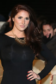 Lucy Pinder glammed up her simple black dress with a stylish gold statement necklace when she attended the premiere of 'The Hobbit.'