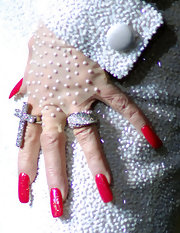 Dolly is the queen of glamour with her long red nails.
