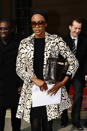 Naomi Campbell departed the Ritz carrying a brow crocodile Birkin bag.