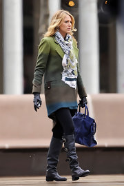 Blake Lively was spotted on the set of 'Gossip Girl' in black leather knee-high boots complete with buckled detailing.