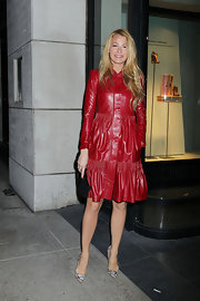 Blake Lively accessorized her red leather coat at the Louboutin soiree with a black suede clutch with python detailing.