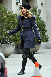 "Another stylish day on the set of ""Gossip Girls"" and Black Lively is looking very all American in her navy trench coat and knee high leather riding boots. Her black beanie adds an unexpected element to her sharp but youthful look."