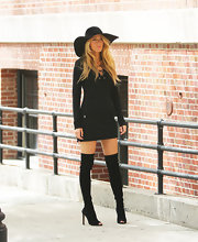 Blake Lively chose a long-sleeve black mini dress for her look while on an NYC photo shoot.