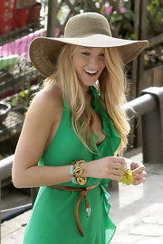 Blake looked chic in a green halter dress with a wide-brimmed, straw, sun hat.