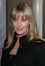 Bo Derek attended the 'Night of 100 Stars' party wearing a super shiny straight 'do with bangs.