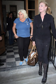 Shannon Tweed wore a pair of lace-up midcalf boots during a dine out with friends.