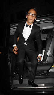 Aston Merrygold looks sharp in this classic black tuxedo.