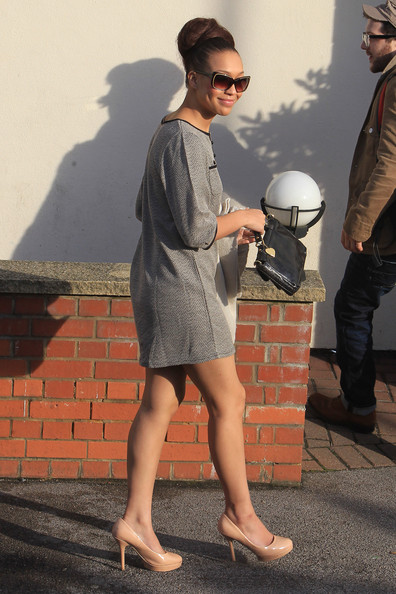 Rebecca Ferguson looked vintage chic in classic nude pumps and a mini shift dress. An elaborate coif completes her look.