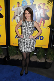 Tina wears a geometric print cocktail dress to the screening of 'Megamind 3D'. She paired this look with black flats and sheer black tights.