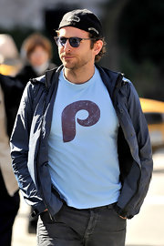 Bradley unzipped his sporty jacket while in New York City.
