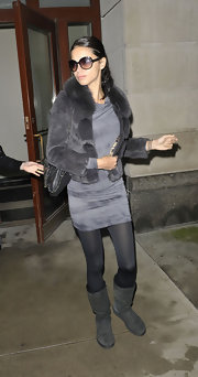 Adriana Lima kept warm in her gray cowl neck dress with a matching fur chubby jacket.