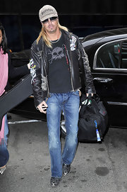 Poison singer Bret Michaels tossed on a baseball cap and sunglasses for this paparazzi moment.