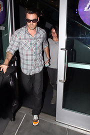 Actor Brian Austin Green has a lettering tattoo spelling out his son Kassius' name on his left arm.
