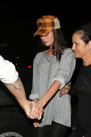 Megan Fox wore a plaid wool cap with earflaps while out for dinner in Beverly Hills.