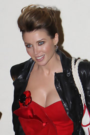 Dannii Minogue wore her hair in a looped and twisted updo while in London.