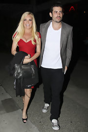 Bridget Marquardt toughened her sexy red cocktail dress with a black leather mini Motorcycle bag.