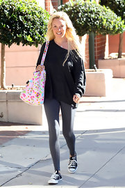 "The usually dolled up Bridget sported a laid back all natural look. Her comfy look was completed with a classic pair of black and white ""Chuck Taylors""."