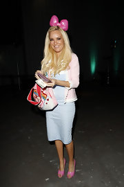What goes better with a pink Hello Kitty bow than bubble gum pink peep toes? Bridget Marquardt pairs both girly accessories with a radiant smile.