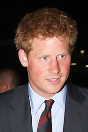 Prince Harry keeps his strawberry tresses short and messy.