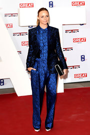 Stella McCartney loves her jumpsuits! Check out this blue iridescent number.