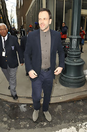 Jonny Lee Miller played it cool and trendy in gray suede loafers while out and about in NYC.