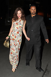 Actress Anna Friel was escorted to the newest nightclub in LA, Trousdale. She topped her flower frock off with a gold sequined evening bag.