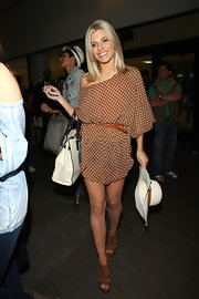 Mollie King teamed her flirty poka dot shirt and short shorts with tan leather platform sandals.