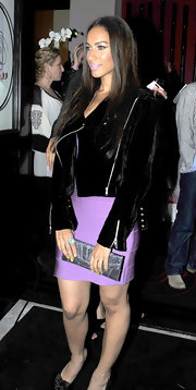 Leona matches her lilac bandage dress with a motorcycle style velvet jacket.  Such a chic combination. with her glitzy clutch and coordinating lilac lips.