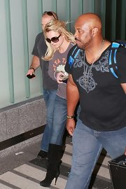 Britney sported scrunched suede boots over jeans with a casual tee.