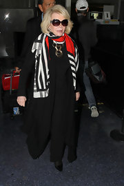 Joan added some color to her all-black ensemble with this black, white, and red scarf.