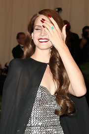 Lana Del Rey wore her long talons painted a vibrant red with ombre tips.