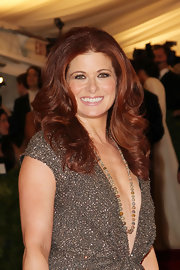 Debra Messing wore her hair in long glossy curls for the Met Gala.