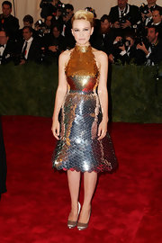Carey Mulligan paired her bold Prada dress with subtle champagne pumps for the Met Gala.