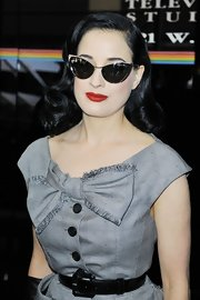 Dita accentuated her enviable hourglass figure with a patent leather belt.